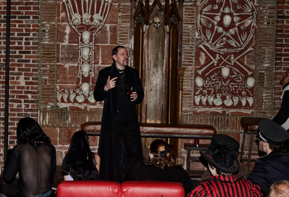 Evan Christopher addressing the crowd at a Gathering in the Dungeon at The Castle